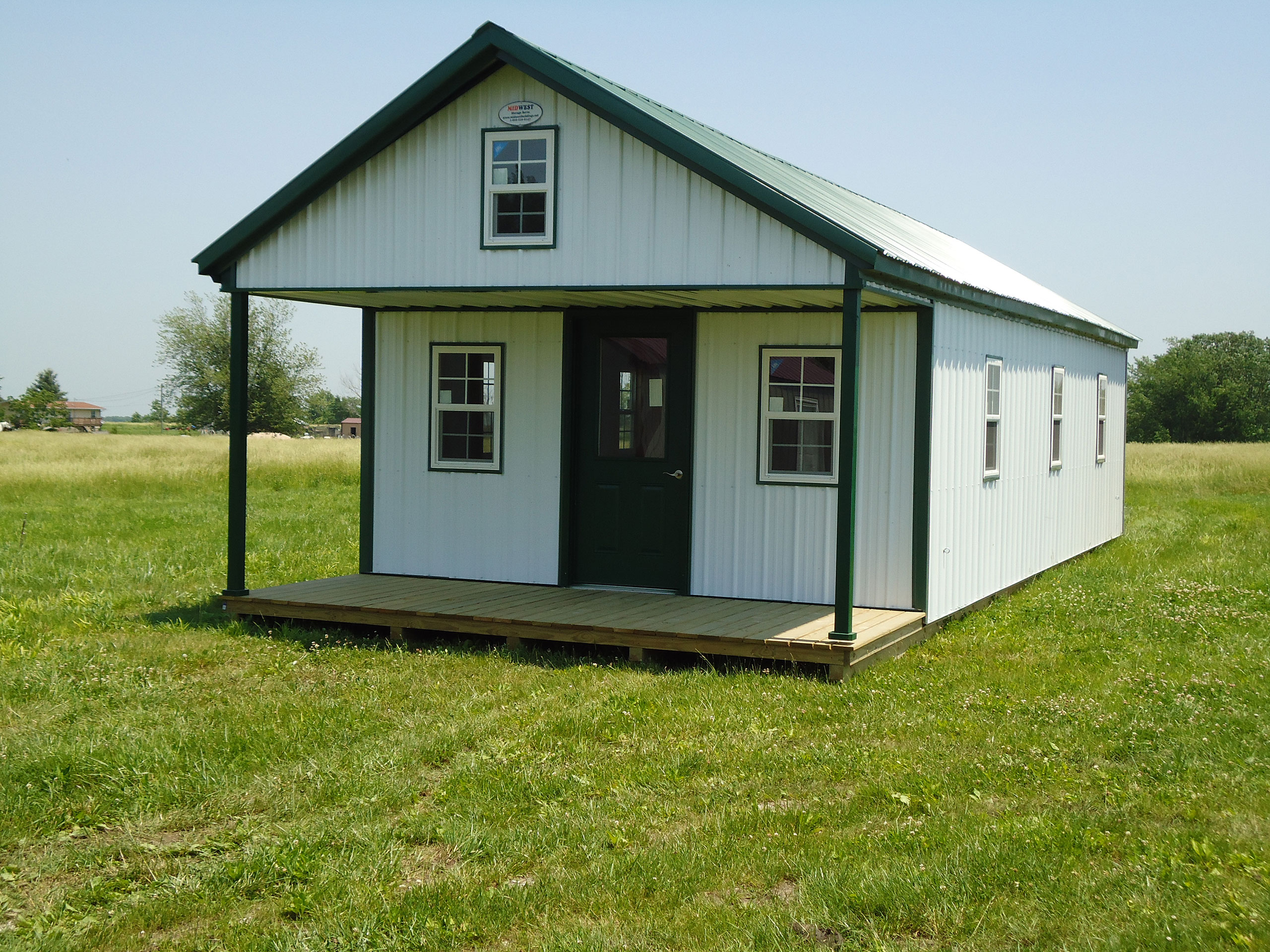 Deluxe cabins midwest storage barns for Metal building cabin